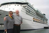 pic of cruise ship  - Senior couple ready for another cruise in front of a cruise ship - JPG