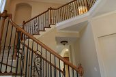 stock photo of bannister  - A beautiful staircase in a luxury home - JPG