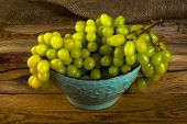 Постер, плакат: White Grapes On Dark Wooden Background
