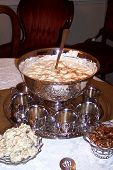 stock photo of punchbowl  - eggnog from this beautiful silver punch bowl awaits party guests.  - JPG
