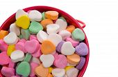 stock photo of valentine candy  - bucket full of candy hearts in assorted colors for valentine - JPG
