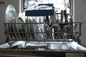 Open dishwasher with clean glass and dishes selective focus Clean glasses after washing in the dishw poster