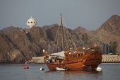 stock photo of oman  - Old wooden ship in the harbor of Muscat Sultanate of Oman - JPG
