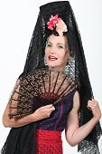 stock photo of senorita  - Woman in Spanish Fancy Dress Costume - JPG