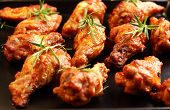 foto of roast chicken  - Photo of Hot chicken wings on baking tray - JPG