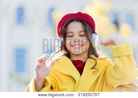 poster of Stereo Sound. Good Vibes Only. Child Girl Autumn Outfit Enjoying Music. Awesome Sound. Girl Kid With