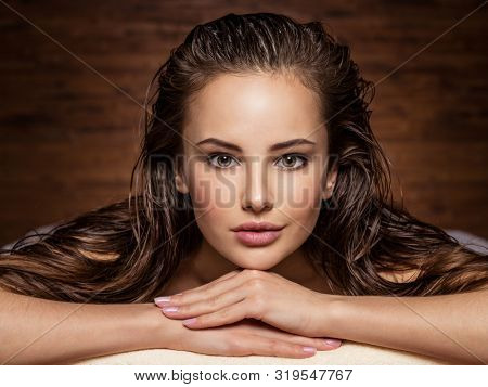 poster of young  woman relaxing in spa salon. Beauty treatment. Spa salon