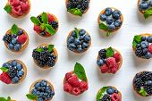 Useful Tartlets With Blueberries, Blueberries, Raspberries In The Shape Of A Heart Isolated On White poster