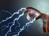 stock photo of sorcerer  - Magician using its fingers to create some energy bolts - JPG
