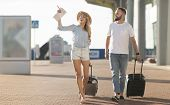 Young Couple Arriving At Airport At New Destination, Ready To Explore The City, Empty Space poster