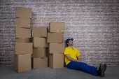 Brazilian Mailman Sleeping In A Deposit With A A Lot Of Boxes. poster