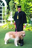 Happy Man Graduated Holding And Showing Degree With His Dog, Idea For Education Concept poster