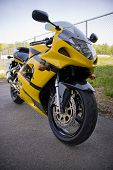 stock photo of crotch  - A brand new yellow motorcycle  - JPG