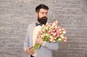 Macho Getting Ready Romantic Date. Tulips For Her. Man Well Groomed Tuxedo Bow Tie Hold Flowers Bouq poster