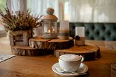 A Cup Of Coffee, Cappuccino And Autumn Decor On Table.hello Autumn. Autumn Decor, Fall Mood, Atmosph poster