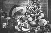 It Is Miracle. Santa Boy Little Child Celebrate Christmas At Home. Lovely Baby Enjoy Christmas. Fami poster