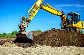 Wheeled Excavator Is Excavating Soil At Construction Site, Project In Progress. poster