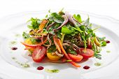 Healthy gourmet salad with sliced beef tongue, arugula, paprika, tomatoes and dressing a la pesto on poster