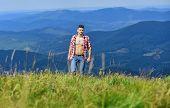 Hiking Concept. Muscular Tourist Walk Mountain Hill. Power Of Nature. Man Unbuttoned Shirt Stand Top poster