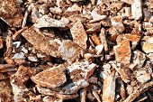 Part Of A Stone Pile Of Rocks For Construction And Boulders Piled, Close Up. Brown Granite. A Large  poster