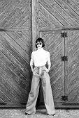 Femininity And Emphasize Feminine Figure. Girl Wear Loose High Waisted Pants. Fashion Shop. High Wai poster