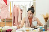 Asian Young Women Fashion Designer  Working On Her Designer In The Showroom,  Lifestyle Stylish Tail poster
