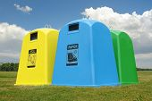 picture of waste disposal  - Recycle containers for paper metal and plastic waste placed on grass over sky - JPG