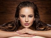 young  woman relaxing in spa salon. Beauty treatment. Spa salon poster