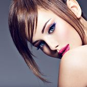 Beautiful redhead girl with style hairstyle. Portrait of a sexy young woman  with big blue eyes. Fas poster