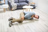 Man Fallen On Floor Having Pain Lying On Floor After Accident poster