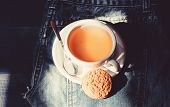Quick Snack Concept. Relaxing Chamomile Tea. Cup Mug Hot Tea And Oat Cookie. Mug Filled Tea Close Up poster