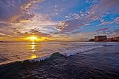 stock photo of waikiki  - Sunset in Honolulu as viewed from Waikiki beach - JPG