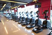 Abstract Blur Of Defocused Sport Gym Interior And Fitness Health Club With Sports Exercise Equipment poster