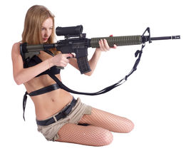 picture of girls guns  - Sexy young aiming woman with rifle - JPG