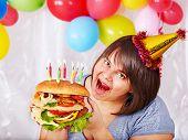 picture of bag-of-dog-food  - Woman eating hamburger at birthday at home - JPG