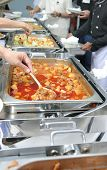 image of chafing  - photograph of food at buffet with people