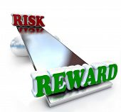 foto of sawing  - The words Risk and Reward on a see - JPG