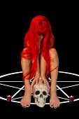 picture of red hair  - redhead woman sitting on pentagram holding human skull - JPG