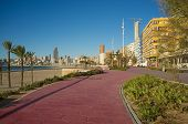 stock photo of costa blanca  - Sunny morning on Benidorm beach promenade - JPG