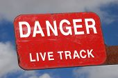 stock photo of railroad yard  - Danger live track sign on a railroad switching yard in Oregon - JPG