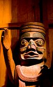 stock photo of totem pole  - An old intricate carved wooden inuit totem - JPG