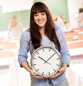 A Young Girl Holding A Clock, Indoor
