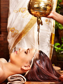 picture of panchakarma  - Young woman having oil Ayurveda spa treatment - JPG