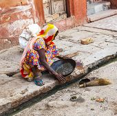 Woman Tries To Find Gold Dust In The Canalisation
