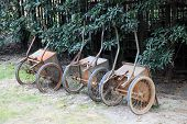 stock photo of hand-barrow  - Three hand barrows in park - JPG