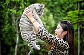 foto of white tiger cub  - pretty women hold baby white bengal tiger - JPG