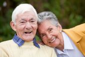 stock photo of old couple  - Portrait of a couple of elders smiling outdoors - JPG
