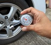 stock photo of air pressure gauge  - checking tire air pressure with meter gauge before traveling for multipurpose - JPG