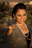 Pretty Young Woman With Small Solar Panel