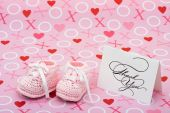 stock photo of thank you card  - A white thank you card with baby booties on a pink love background thank you note - JPG
